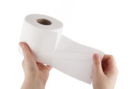 Hand tearing toilet paper Stock Photo - 10587107
