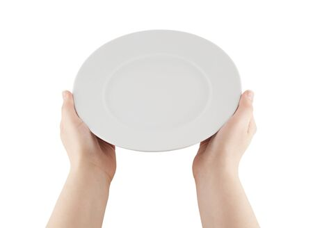 Hands holding empty plate  photo
