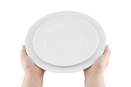 Hands holding empty plates  photo