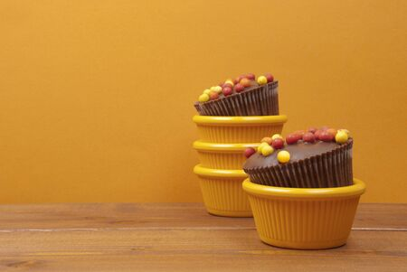 Two cupcake on wooden table photo