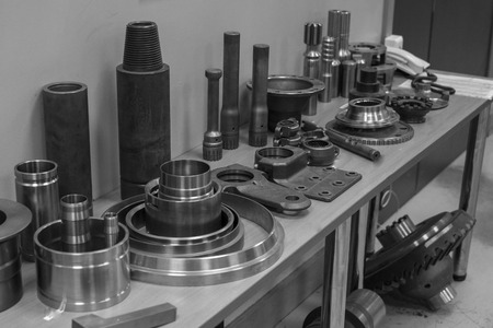 turning table: Industrial lathe tool and high precision cnc turning parts. high precision automotive machining mold and die part. CNC prosessed parts on table.