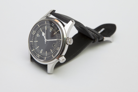 calibre: Mens luxury diver watch with synthetic strap isolated on white. Stock Photo
