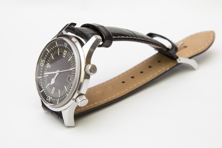 Mens luxury diver watch with leather strap isolated on white.