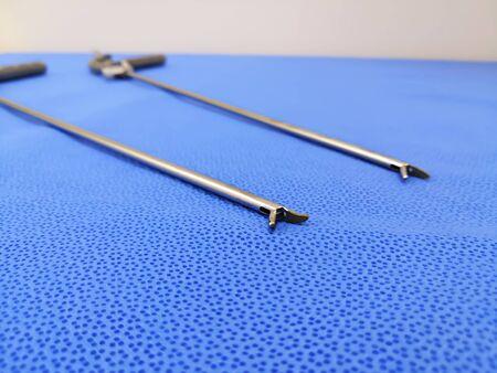 Closeup Image Of Laparoscopic Needle Holder. Focused On The Tip Of Instrument.