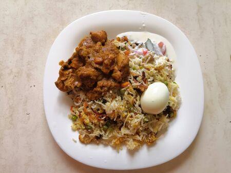 Colorful Spicy Kerala Style Egg Biryani or Thalasheri Biryani