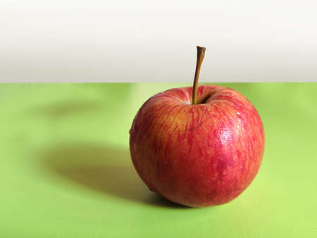 Beautiful Single Red Apple On Green Table