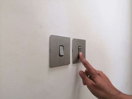 Turning On Electrical Switch With Male Finger