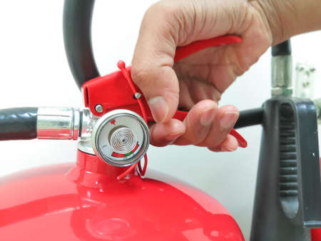 Closeup Image Of Holding Fire Extinguisher