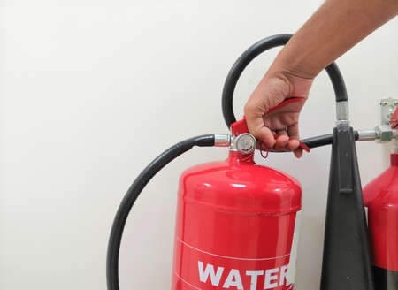 Closeup Image Of Holding Water Fire Extinguisher