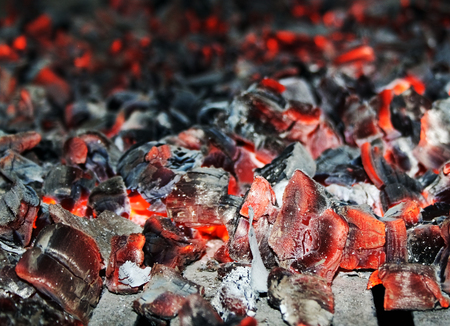 smoldering: Hot red and black  embers are smoldering in oven