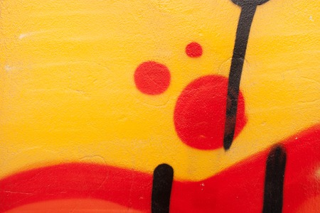 brightly colored: Concrete wall with colored spots of paint in the form of an abstract pattern