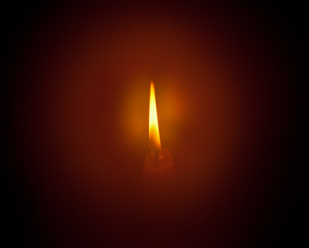 aura: Candle flame and the aura around it in the dark