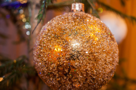 Close-up beautiful Christmas toy Golden textured  sphere. Stock Photo