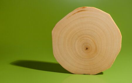 One polished and oiled alder saw cut is standing on green background. Stock Photo