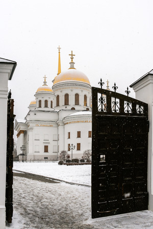 street creed: Opened gate and pathway to temple in snowy winter day. Orthodox temple. Novo-Tikhvinsky women monastery, Ekaterinburg.