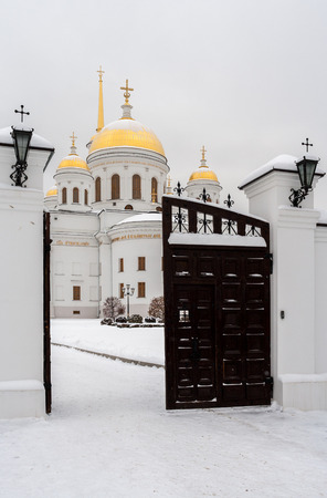 street creed: Opened gate to temple in snowy winter day. Orthodox temple. On photo - Novo-Tikhvinsky women monastery, Ekaterinburg.