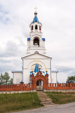 Pathway in form of stone steps to Church of the Dormition in summer day. Novoutkinsk, Russia.