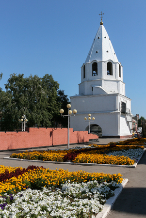 Syzran. View on the Kremlin. Flower beds in the Park behind the Kremlin in summer. Stock Photo