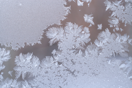 windows frame: Beautiful frosty pattern from snowflakes on winter window glass and copy space.