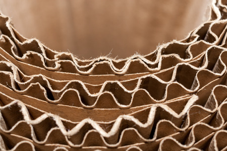 Close-up semicircular wavy edges of layers of corrugated cardboard. Top view.