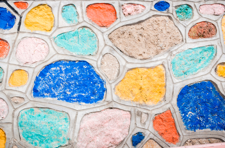 Background of natural stones, fastened together with cement and painted with bright colored paints. Stok Fotoğraf