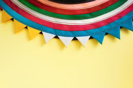 Semicircular Handmade Cloth Stitched From Colorful Stripes On Top Of Bright Pastel Yellow Background Stock