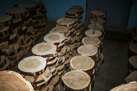 Top view of row of cross saw cuts, stacked to dry on wood factory stockpile.