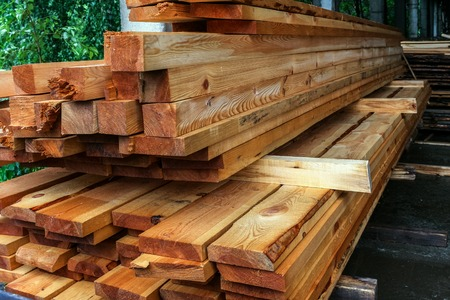 Wood factory stockpile and lumber boards.