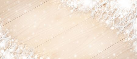 Christmas banner with white decorative branches, covered with snow on light wooden background with copy space. Imagens