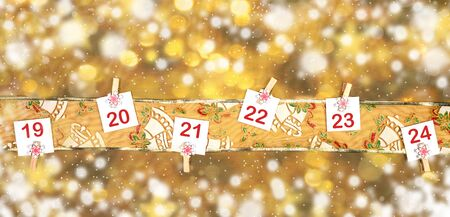 19-23 part of Advent calendar on ornamented golden ribbon on background of blurred golden bokeh with snow.