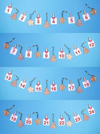 Creative collage of Advent calendar in gradient blue. Sheets with numbers and wooden christmas toys laid out as arcs.