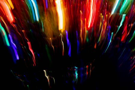 Colorful blurred vertical glowing stripes on black background. Abstract neon background.