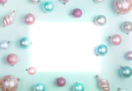 Christmas festive mockup flat lay of Christmas balls around blank white sheet on trendy Neo Mint background. Top view, flat lay, copy space.