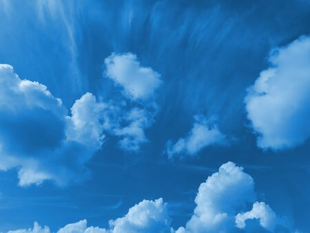 Beautiful sky with white clouds. Trendy toning in color 2020 Classic Blue. Natural air background.