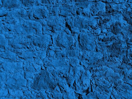 Close-up stone wall toned in trendy color 2020 Classic Blue as background or wallpapers. Natural fashionable painted stony texture.
