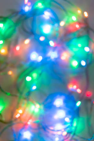 Festive Christmas blurred background of bright glowing colored garland. Xmas mockup with copy space. 免版税图像