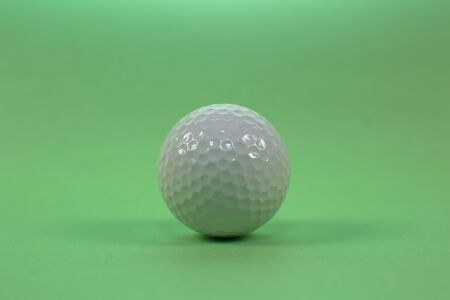 trainer: golf ball on a green background