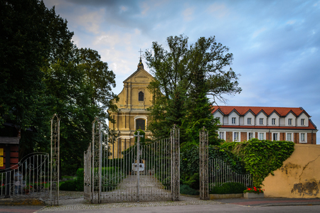 ner: Monastery complex - monastery, music school, church in Lutomiersk, Poland Stock Photo