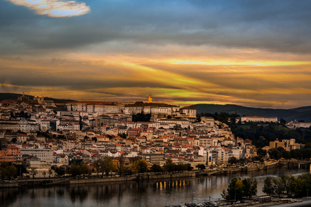 Coimbra city illuminated by the setting sun, Portugal Stock Photo