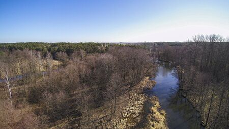 Flight over a wild river in central Poland, March 2020. Stock Photo