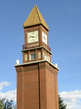 clocktower: Rusty red brick clock tower with gargoyles