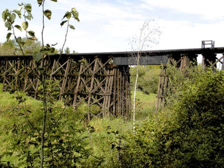 trestle: Wooden train trestle over river Stock Photo