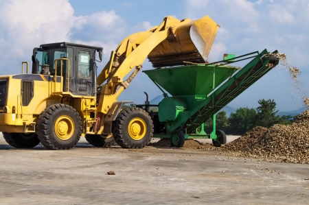 front end loader: Front End Loader with Cassava grinding machine  Stock Photo
