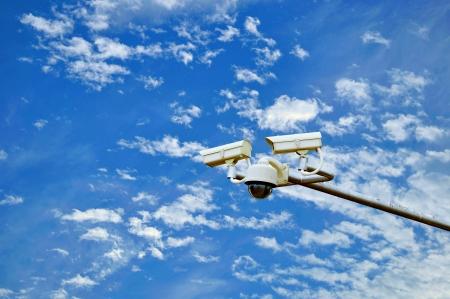 anti terrorist:  CCTV Security Camera  Blue sky and  clouds Background
