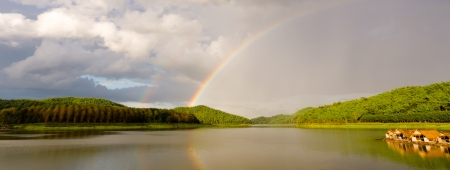 rainbow on river photo