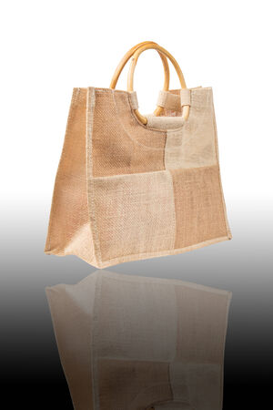 brown fabric  bag isolated on a white  photo