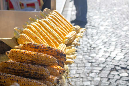 Grilled corn on the stand