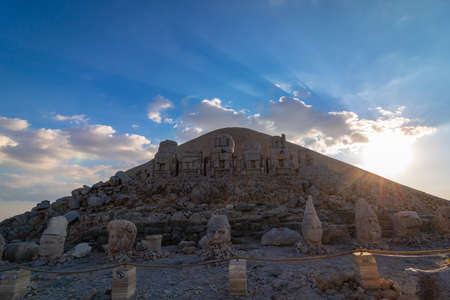 Eastern Terrace of Mount Nemrut at sunset. Statues of King Antiochus I of Commagene and some of different cultures gods. Kahta Adiyaman Turkey.