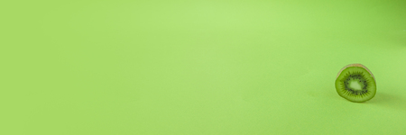 Perfect Fresh Green kiwi fruit Isolated on green Background Full Depth of Field Banner