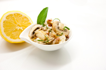 Mushroom risotto on white plate, close up view Stock Photo